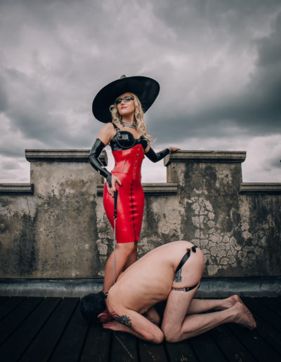 Photo of Mistress Alexandra Wildfire with slave at feet
